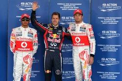 Third place Lewis Hamilton, McLaren Mercedes, pole winner Sebastian Vettel, Red Bull Racing and seco
