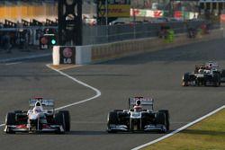 Kamui Kobayashi, Sauber F1 Team en Rubens Barrichello, Williams F1 Team