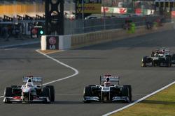 Kamui Kobayashi, Sauber F1 Team and Rubens Barrichello, Williams F1 Team