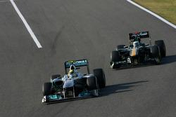 Nico Rosberg, Mercedes GP and Heikki Kovalainen, Team Lotus