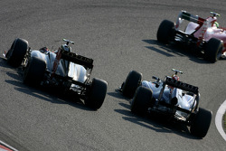Mark Webber, Red Bull Racing and Vitaly Petrov, Lotus Renalut F1 Team