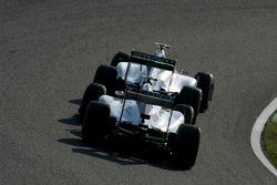 Michael Schumacher, Mercedes GP and Sergio Perez, Sauber F1 Team