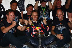 Sebastian Vettel, Red Bull Racing new world champion celebrates with the team, Christian Horner, Red