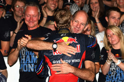 Sebastian Vettel, Red Bull Racing new world champion celebrates with the team and Adrian Newey, Red