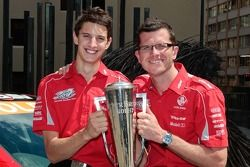 Race winners Garth Tander and Nick Percat celebrate in Sydney