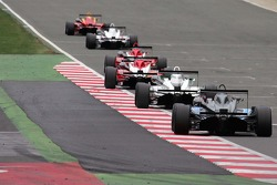 F3 cars race close down the international pit straight