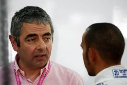 Rowan Atkinson, British actor, talks with Lewis Hamilton, McLaren Mercedes