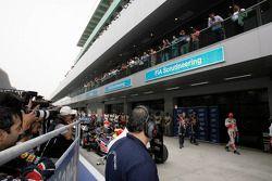 Sebastian Vettel, Red Bull Racing with Mark Webber, Red Bull Racing and Lewis Hamilton, McLaren Merc