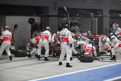 Lewis Hamilton, McLaren Mercedes pit stop and gets a new front wing