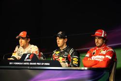 Second place Jenson Button, McLaren Mercedes, race winner Sebastian Vettel, Red Bull Racing, third p