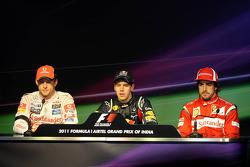 Second place Jenson Button, McLaren Mercedes, race winner Sebastian Vettel, Red Bull Racing, third place Fernando Alonso, Scuderia Ferrari