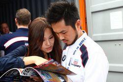 Charles Ng, BMW 320si, Liqui Moly Team Engstler and his girlfriend