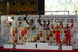 GT300 overall podium: first place Nobuteru Taniguchi, Taku Bamba, second place Masami Kageyama, Tomo