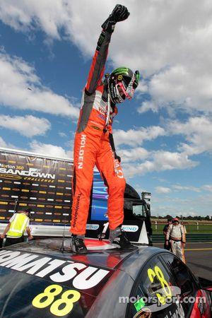 Race winner Jamie Whincup celebrates