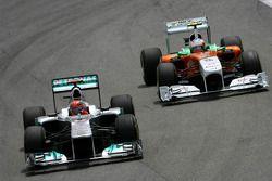 Michael Schumacher, Mercedes GP en Paul di Resta, Force India F1 Team
