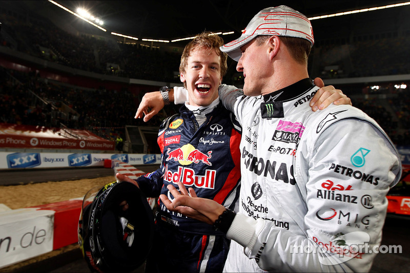 Winners Sebastian Vettel and Michael Schumacher