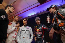 Jenson Button, Michael Schumacher, Sebastian Vettel y Travis Pastrana