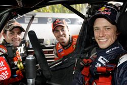 Casey Stoner tests a V8 Supercar with Craig Lowndes and Jamie Whincup