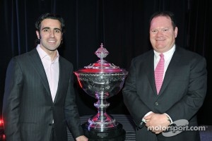 Dario Franchitti and Chip Ganassi with the IZOD IndyCar Series World Championship Trophy