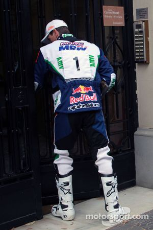 Marc Coma delivers mail in Barcelona on his KTM