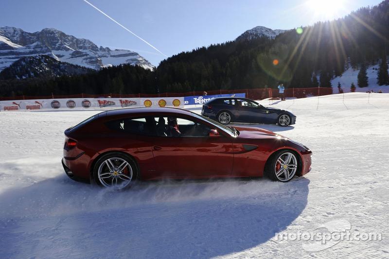 Fernando Alonso and Felipe Massa race the new Ferrari FF