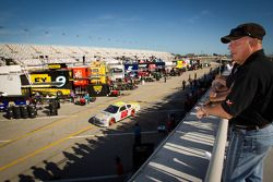 Fans watch garage activity as A.J. Allmendinger, Penske Racing Dodge drives by