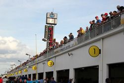 Fans watch track and garage action from the fan zone deck