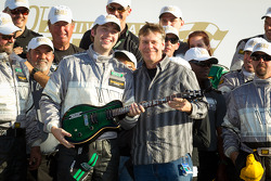 GT victory lane: class winners John Potter with the guitar given to the winning team owner