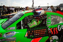 Pole winner Danica Patrick, JR Motorsports Chevrolet gets out of her car after setting the fastest q
