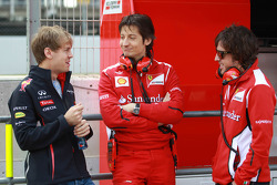 Sebastian Vettel, Red Bull Racing with Massimo Rivola, Scuderia Ferrari  Sporting Director and Fernando Alonso, Scuderia Ferrari