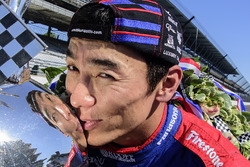 Takuma Sato, Andretti Autosport Honda celebrates his win of the Indy 500 by kissing the Borg-Warner Trophy on the yard of bricks