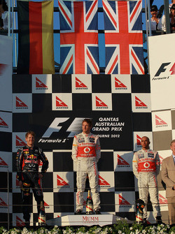 Sebastian Vettel, Red Bull Racing with Jenson Button, McLaren Mercedes and Lewis Hamilton, McLaren M