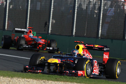Sebastian Vettel, Red Bull Racing leads Timo Glock, Marussia F1 Team