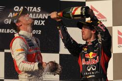 Jenson Button, McLaren Mercedes et Sebastian Vettel, Red Bull Racing