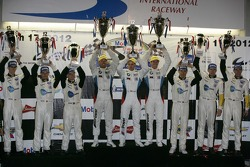 ALMS GTE-Pro podium: first place Joey Hand, Dirk Muller, Jonathan Summerton, second place Oliver Gav