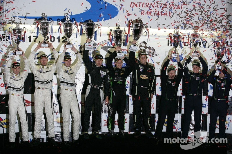 ALMS GTC podium: first place Bill Sweedler, Townsend Bell, Dion von Moltke, second place Cooper MacN
