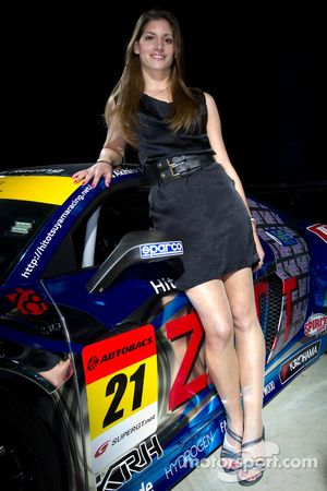 Cyndie Allemann with her #21 Hitotsuyama Racing Audi R8 LMS race car