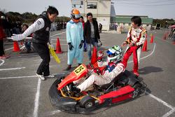 Go-kart charity event: Cyndie Allemann, Akira Mizutani and Michael Kim