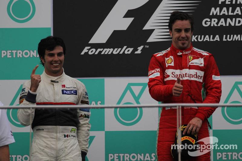 Segundo lugar Sergio Pérez, Sauber F1 Team y Fernando Alonso, Scuderia Ferrari