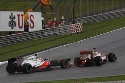Jenson Button, McLaren Mercedes and Narain Karthikeyan, HRT Formula One Team make contact