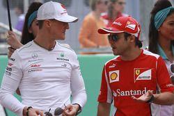 Michael Schumacher, Mercedes GP y Felipe Massa, Scuderia Ferrari