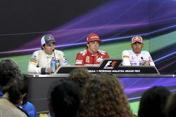 Race winner Fernando Alonso, Scuderia Ferrari, second place Sergio Perez, Sauber F1 Team, third plac