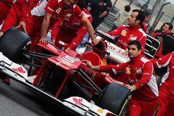Ferrari F2012 pushed to scrutineering by mechanics