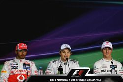 Qualifying top three in the FIA Press Conference, Lewis Hamilton, McLaren, second; Nico Rosberg, Mer