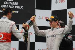 Jenson Button, McLaren Mercedes and Nico Rosberg, Mercedes AMG Petronas