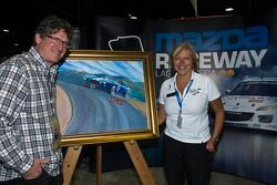 Artwork for 2012 Rolex Monterey Motorsports Reunion by Bill Patterson (left) and Gill Campbell Mazda Raceway Laguna Seca
