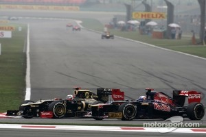 Kimi Raikkonen, Lotus F1 Team and Jean-Eric Vergne, Scuderia Toro Rosso