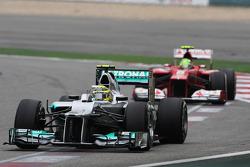Nico Rosberg, Mercedes AMG F1 leads Felipe Massa, Ferrari