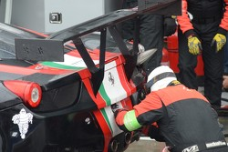 A broken left rear airjack on the #51 AF Corse Ferrari requires