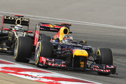 Sebastian Vettel, Red Bull Racing leads Kimi Raikkonen, Lotus